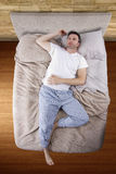 Top View of Man On Bed Royalty Free Stock Image