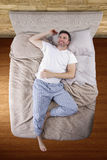 Top View of Man On Bed Stock Photos
