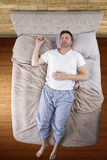 Top View of Man On Bed Royalty Free Stock Images
