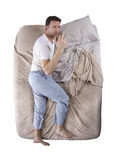 Top View of Man On Bed Stock Photo