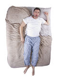 Top View of Man On Bed Stock Photography