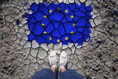 Top view of a man and cracked eu flag Stock Photography