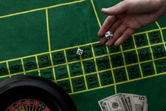 Top view of man gambling on roulette at casino, gambling. Addiction concept royalty free stock photos