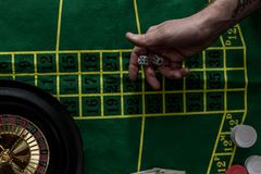 Top view of man gambling on roulette at casino, gambling. Addiction concept royalty free stock images
