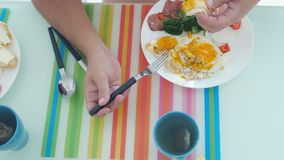 Top view of man has morning breakfast fried egges with vegetables drinks tea. royalty free stock image