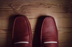Top view of man in leather shoes. Top view of a man wearing a lether shoes standing on a wooden floor Stock Images