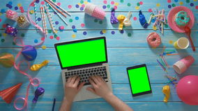 Top view man planning birthday party using laptop computer and digital tablet green screen stock video footage