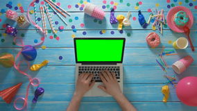 Top view man planning birthday party using laptop computer green screen stock video