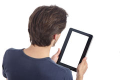 Top view of a man reading a tablet showing its blank screen. Isolated on a white background Royalty Free Stock Photo