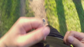 TOP VIEW: Man runs on a forest path. TOP VIEW: Man runs on forest path stock video footage