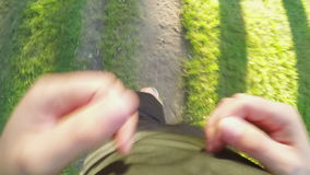 TOP VIEW: Man runs on a forest path (slow motion). TOP: Man runs on a forest path (slow motion stock footage