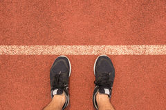 Top view man wear running shoes on the starting line Stock Image