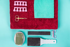 Top view of manicure and pedicure equipment on blue background. Still life Royalty Free Stock Photos
