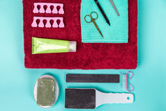 Top view of manicure and pedicure equipment on blue background. Still life Royalty Free Stock Images