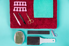 Top view of manicure and pedicure equipment on blue background. Still life Royalty Free Stock Image