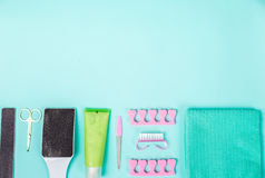 Top view of manicure and pedicure equipment on blue background. Still life. Copy space Stock Photos