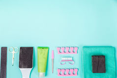Top view of manicure and pedicure equipment on blue background. Still life. Copy space Royalty Free Stock Photography