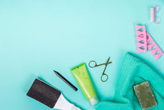 Top view of manicure and pedicure equipment on blue background. Still life. Copy space Royalty Free Stock Photo