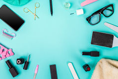 Top view of manicure and pedicure equipment on blue background. Still life. Copy space Stock Image