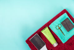 Top view of manicure and pedicure equipment on blue background. Still life. Copy space Royalty Free Stock Photos