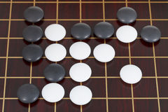 Top view of many black and white go game stones Stock Images