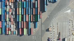 Top view of many cargo containers in port. Straight down drone shot of modern industrial port in Barcelona with cargo containers. Aerial view of import export stock video