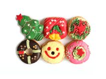 Top View of Many Colorful Christmas Decorated Doughnuts Sweets Isolated on White Background. Happy Holidays stock photography