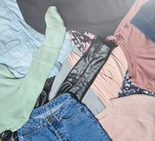 Top view of many different women& x27;s clothing layout. Second hand. Stock Photo