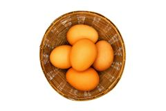 Top view of many egg putting in the weave basket isolated on white background. Freshness food and healthy Royalty Free Stock Images