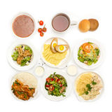 Top view of many plates with food Royalty Free Stock Images