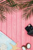 Top view of map and instant print camera on pink. Wooden surface stock image
