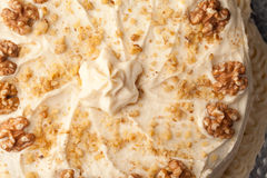 Top view of maple walnut cinnamon cake - close-up Royalty Free Stock Image