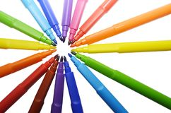 Multicolors marker pens on white background isolated. Top view markers. Multicolors marker pens on white background isolated.Markers make a sun Stock Image