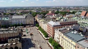 Top view of the Market Square - Krakow - Poland. KRAKOW, POLAND - AUGUST 3, 2017: top view of the Market Square Rynek Glowny It is a biggest square measuring 200 stock video footage
