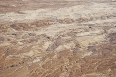 Top view from Masada fortress to the Judaean desert and the Dead Sea. The desert land of Israel. Background of canyon in the. Desert. Desert in which 40 years royalty free stock images