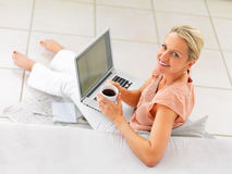Top view of mature woman using laptop Royalty Free Stock Photos