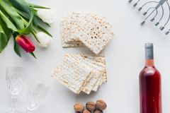 Top view of matza. And wine with flowers, jewish Passover holiday concept Stock Images
