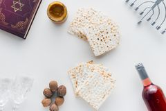Top view of matza. And torah on white surface, Pesah celebration concept Royalty Free Stock Image