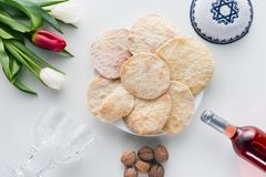 Top view of matza. And wine on white table, Pesah celebration concept Stock Images