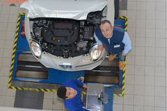 Top view mechanic and apprentice working Stock Images