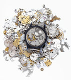Top view of mechanic watch on heap of spare parts Royalty Free Stock Photography