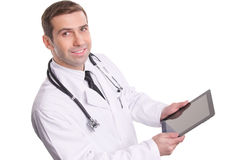 Top view of medical doctor using tablet pc with empty screen / I Royalty Free Stock Image