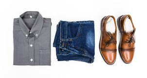 Top view men apparel, grey shirt, blue jean, leather shoes brown. Color on white background royalty free stock photo