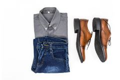Top view men apparel, grey shirt, blue jean, leather shoes brown. Color on white background Stock Image