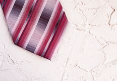 Top view of a mens trendy striped tie on a beautiful background. Happy Fathers Day greeting card concept royalty free stock photography
