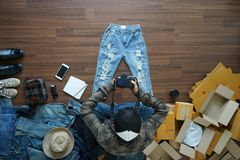Top view of men shooting take a photo jeans pants and fashion accessories Royalty Free Stock Photos