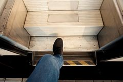 Top view Men are stepping up the ladder on the train. Royalty Free Stock Images