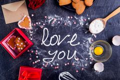 Free Top View Meringue Cream Lettering Love You On The Black Stone Background With Ingredients, Flower, Gift Box With Cookies And Decor Royalty Free Stock Photography - 105902437