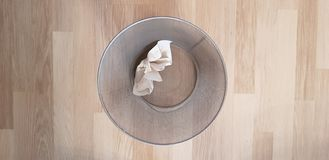 Top view of metal trash bin with one folded paper royalty free stock photography