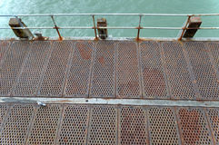 Top view of metal walkway on Seaside pier in Bournemouth UK. Royalty Free Stock Photo